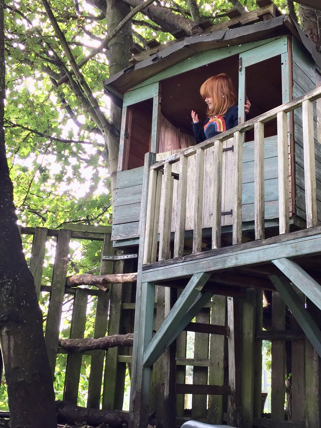Holly enjoying the farm's treehouse.